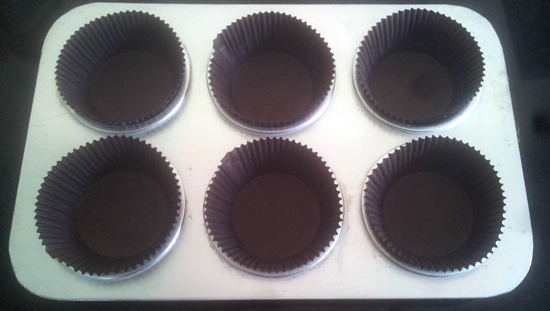 Place cupcake linings in a tray