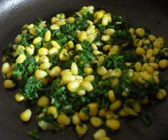 Corn and spinach cooked