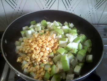 Adding chana dal and dudhi