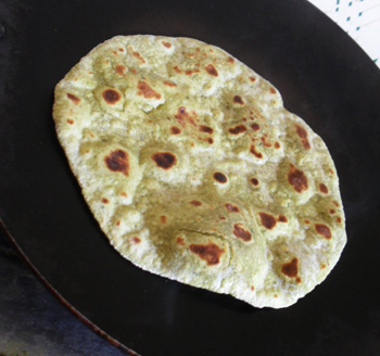 Baking mint roti on gridle