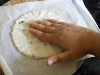 Patting down the south indian breakfast roti 5