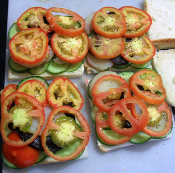 Adding tomatoes to veg sandwich